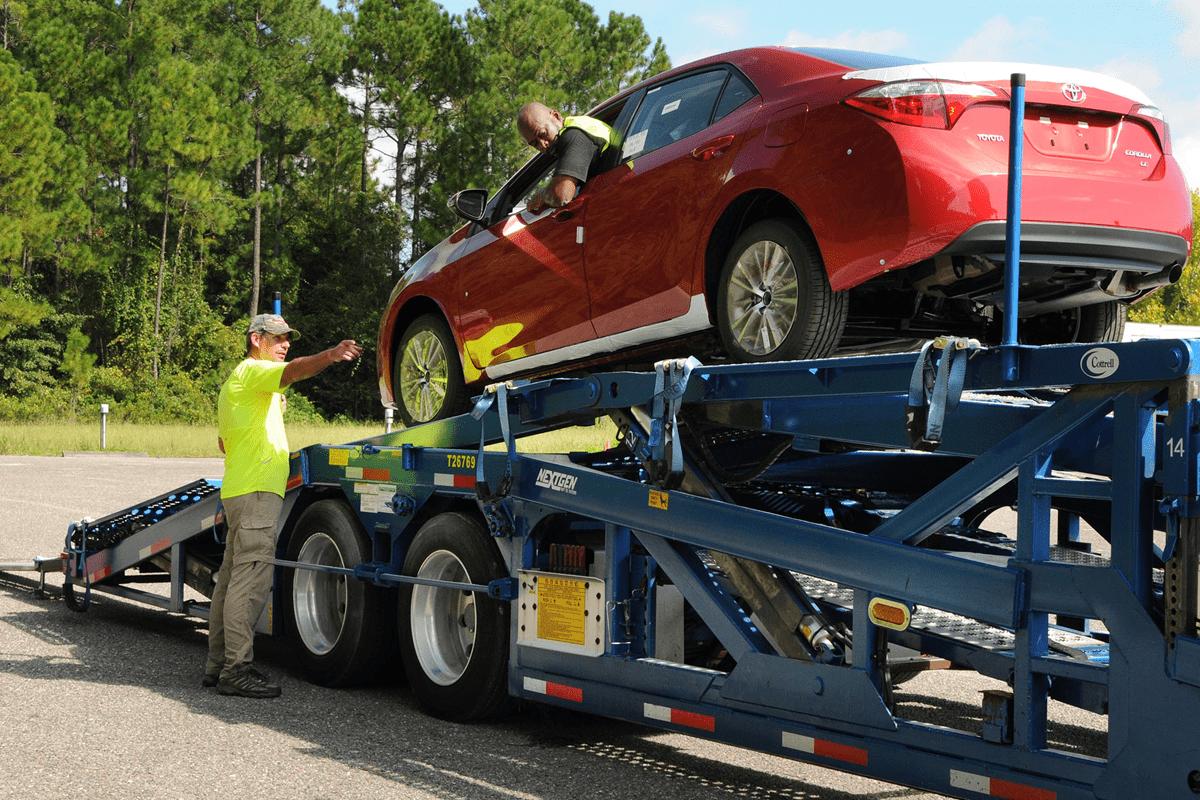 dovoz auta zo zahraničia, odťahová služba, odťahové auto, červené auto